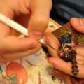 An artist painting a Warhammer miniature